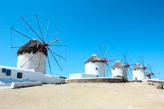 Mykonos windmills. Five famous windmills the landmark of mykonos island against the blue sky Royalty Free Stock Photography
