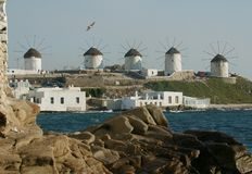 Mykonos Windmills. Famous windmills in harbor of mykonos island greece Stock Image