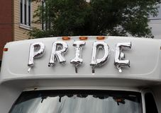 Pride Mylar Ballons On Vehicle In Parade. Mylar balloons spelling pride on vehicle for Edmonton Alberta`s annual pride parade royalty free stock photography