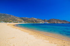 Mylopotas yellow sand beach, Ios island, Cyclades, Aegean, Greece. View on Mylopotas yellow sand beach, Ios island, Cyclades, Aegean, Greece royalty free stock image