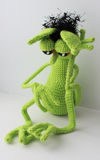 Mymra in sorrow. knitted toy Stock Photography