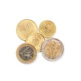 Mynt 10 cent till euro som två isoleras på vit Arkivbild