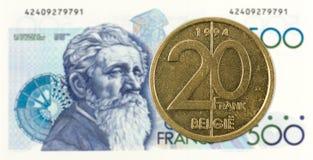 mynt för belgisk franc 20 mot anmärkning för belgisk franc 500 fotografering för bildbyråer