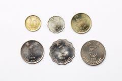 Mynt från Hong Kong på en vit bakgrund royaltyfri foto