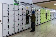 Mynt fungeringsskåp i Japan Arkivfoto