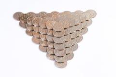 mynt gjorde pyramiden royaltyfria bilder