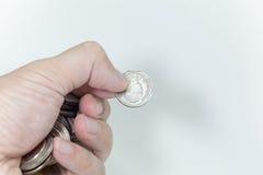 Mynt i behandla som ett barnhanden, pengar i behandla som ett barnhanden, pengar i behandla som ett barn Royaltyfri Fotografi