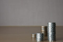 Mynt i fyra kolonner Arkivbilder