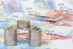 Mynt och nya euroräkningar Royaltyfria Foton