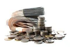Mynt- och pengarbunt Arkivfoton