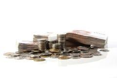 Mynt- och pengarbunt Royaltyfri Bild