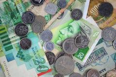 Mynt och sedlar av olika länder Royaltyfria Bilder