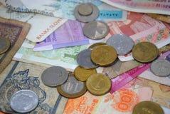 Mynt och sedlar av olika länder Royaltyfri Fotografi