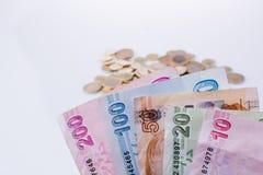 Mynt och sedlar för turkisk Lira sid - förbi - sidan Arkivbilder