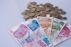 Mynt och sedlar för turkisk Lira sid - förbi - sidan Fotografering för Bildbyråer