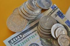 Mynt och valutor arkivfoto