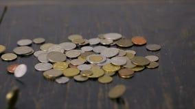 Mynt på den svarta tabellnärbilden lager videofilmer