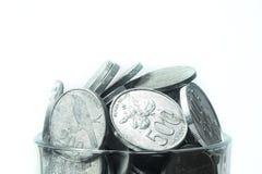 Mynt på exponeringsglas Arkivfoto