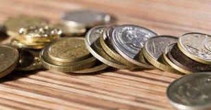 Mynt på tabellen Makro royaltyfri foto