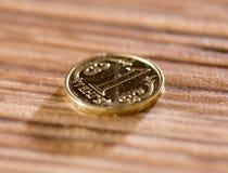 Mynt på tabellen Makro royaltyfri bild