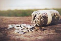 Mynt på trät Royaltyfri Foto