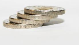 Mynt på vit Arkivbilder