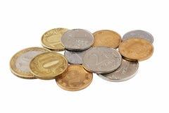 Mynt på vit bakgrund Royaltyfri Foto