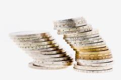 mynt pile olikt Arkivbilder