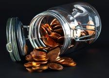 mynt som ut spiller kruset arkivfoton