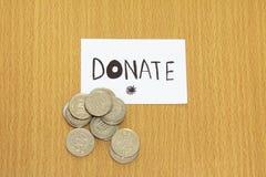 Mynta och donera pengar Royaltyfri Fotografi
