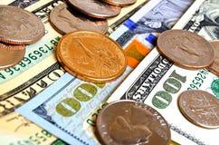 Myntar dollar USA och räkningar Royaltyfri Foto