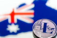 Myntar litecoin, mot bakgrunden av Australien och Austen Royaltyfria Foton