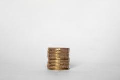 myntbunt på vit finans för affär för bakgrundspengarvärde Royaltyfri Bild