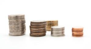 Myntbuntar på en vit Arkivfoto