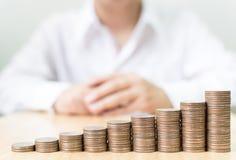 Myntbuntmoment som upp till växer finansiell affär för framgång med bu Royaltyfri Bild