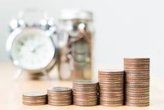 Myntbuntmoment som upp till växer finansiell affär för framgång med cl Arkivfoton