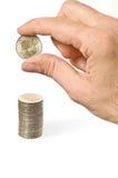 mynthandpengar över stapel sätter Fotografering för Bildbyråer