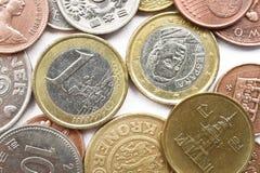 Myntsamling med gamla mynt Arkivbilder