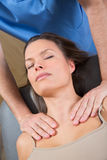 Myofascial therapy on beautiful woman shoulders Stock Images