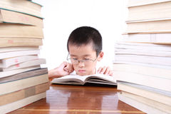 Myopia boy. Myopia is because reading incorrect posture royalty free stock images