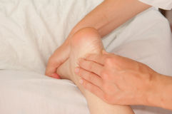 Myotherapy and trigger points on athlete's foot Stock Photo