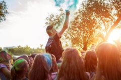 Myrhorod, Ukraine - June 16, 2019: Group of a young people throwing paints on indian Holi festival of colors royalty free stock photos
