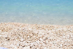 The  Myrthos beach  with little white stones and crystal clear waters blue Royalty Free Stock Photos