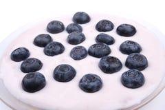 Myrtilles avec du yaourt Images libres de droits