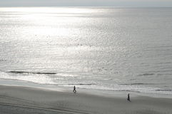 Myrtle beach. With two people strolling at sunset Royalty Free Stock Photos