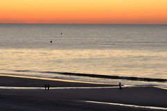 Myrtle Beach Dawn. A serene dawn at Myrtle Beach SC shows calm waters, clear sky and tidal pools and the promise of a beautiful day stock image