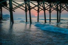 Myrtle beach south carolina. Sunrise under the pier at myrtle beach south carolina Royalty Free Stock Photos