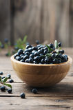 Myrtle berry on the wooden table. Selective focus stock images