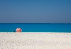 Myrtos beach. Lonely sun umbrella in Myrtos beach. Kefalonia Island, Greece Royalty Free Stock Photo