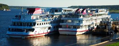 Myshkin ships editorial. MYSHKIN, RUSSIAN - AUGUST 27, 2016:View on cruise liners waiting near town terminal on Volga river in Myshkin, Russia Stock Images